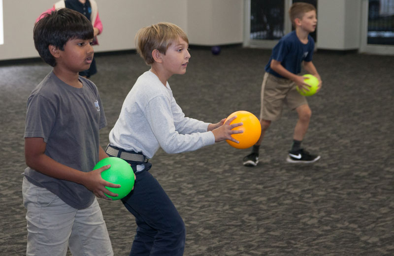 students playing in physical education class