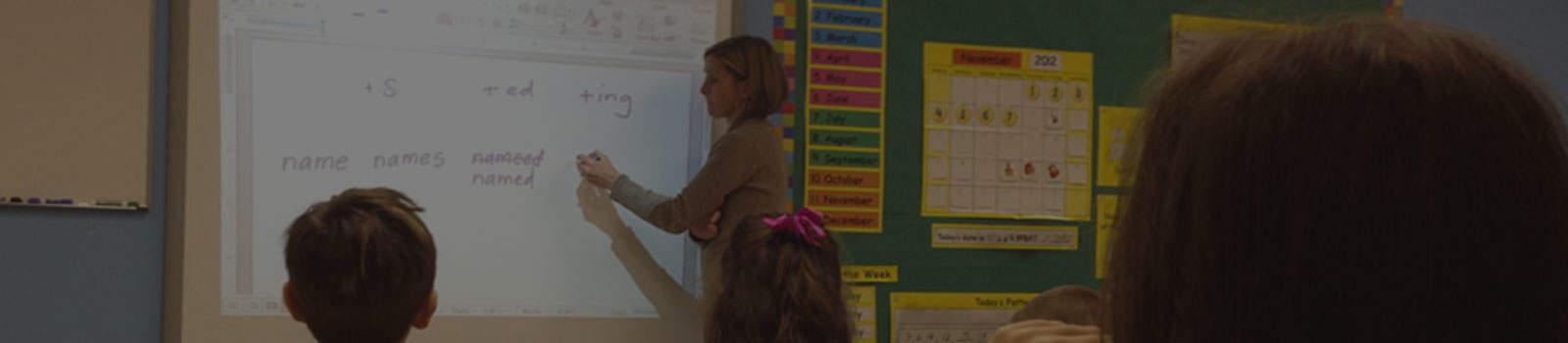 teacher using whiteboard